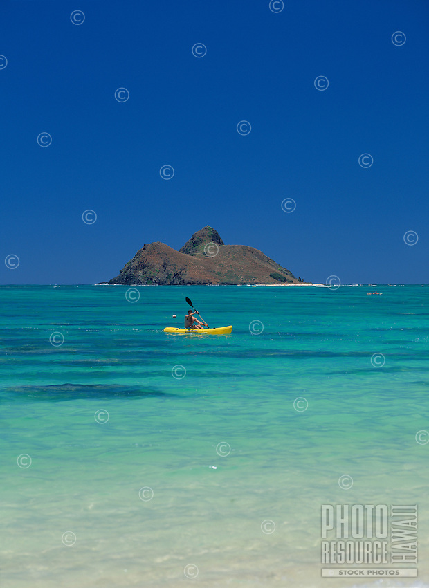Kayaking at Lanikai Beach, Oahu, Hawaii.In the background is one of the Mokulua islets.
