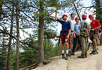 Photo story of Philmont Scout Ranch in Cimarron, New Mexico, taken during a Boy Scout Troop backpack trip in the summer of 2013. Photo is part of a comprehensive picture package which shows in-depth photography of a BSA Ventures crew on a trek.  In this photo a BSA Venture Crew awaits instruction before starting  their climb to the top of  a natural surface rock at Cimarroncito Camp in the backcountry at Philmont Scout Ranch.   <br /> <br /> <br /> The  Photo by travel photograph: PatrickschneiderPhoto.com