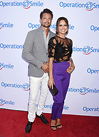 SANTA MONICA, CA - SEPTEMBER 09:  Singer-actor David Charvet (L) and actress-dancer Brooke Burke-Charvet attend Operation Smile's Annual Smile Gala at The Broad Stage on September 9, 2017 in Santa Monica, California.<br /> CAP/ROT<br /> &copy;ROT/Capital Pictures