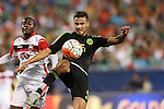 15 July 2015: Diego Reyes (MEX) (5) clears the ball away from Keron Cummings (TRI) (20). The Mexico Men's National Team played the Trinidad & Tobago Men's National Team at Bank of America Stadium in Charlotte, NC in a 2015 CONCACAF Gold Cup Group C match.