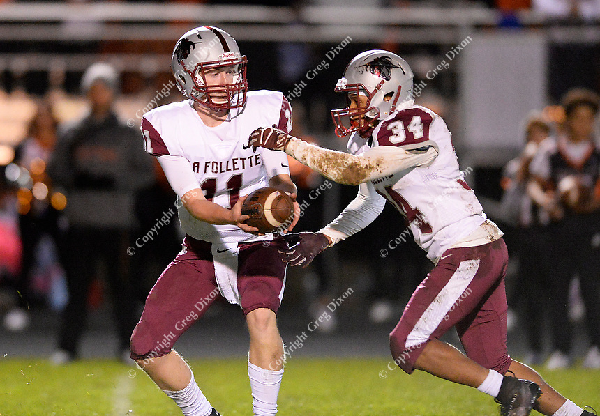 La Follette quarterback, Ben Probst, hands off to Jaylend Brown, as Madison La Follette takes on Verona in Wisconsin Big Eight Conference high school football on Friday, 10/4/19 at Verona High School's Curtis Jones Field
