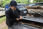 Thap Lan chief Taywin Meesap, shows hidden compartment in vehicle used by Siam rosewood poachers, Thap Lan National Park, Dong Phayayen-Khao Yai Forest Complex, eastern Thailand (August 2014)
