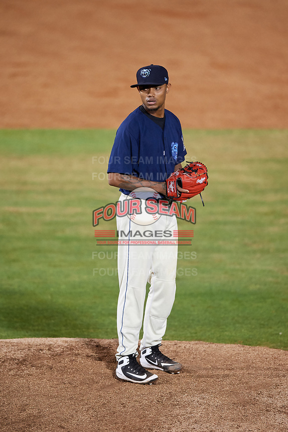 Mobile BayBears relief pitcher Adrian Almeida (37) gets ready to deliver a pitch during a game against the Chattanooga Lookouts on May 5, 2018 at Hank Aaron Stadium in Mobile, Alabama.  Chattanooga defeated Mobile 11-5.  (Mike Janes/Four Seam Images)