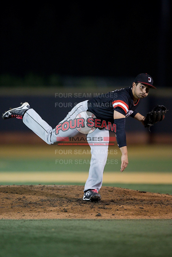 Davidson Wildcats relief pitcher Peyton Hopkins (14) follows through on his delivery against the Wake Forest Demon Deacons at David F. Couch Ballpark on February 28, 2017 in Winston-Salem, North Carolina.  The Demon Deacons defeated the Wildcats 13-5.  (Brian Westerholt/Four Seam Images)