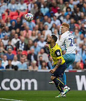 Kane Hemmings of Oxford United & Ryan Haynes of Coventry City during the The Checkatrade Trophy / EFL Trophy FINAL match between Oxford United and Coventry City at Wembley Stadium, London, England on 2 April 2017. Photo by Andy Rowland.