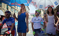 Johan Esteban Chaves (COL/Orica-GreenEDGE) 'looking up' to the model next to him on the ceremonial 'leaders' jerseys' start line<br /> <br /> 2015 Giro<br /> st4: Chiavari - La Spezia (150km)