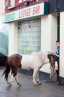 4/10/2010.  9 year old Dany O Shea from Cork is pictured with Sam the pony outside the Emerald bar at the Ballinasloe Horse Fair, Ballinasloe, County Galway, Ireland. Picture James Horan