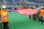 07 August 2008: Olympic volunteers carry the flag of the United States onto the field, pregame.  The men's Olympic team of the United States defeated the men's Olympic soccer team of Japan 1-0 at Tianjin Olympic Center Stadium in Tianjin, China in a Group B round-robin match in the Men's Olympic Football competition.