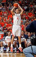 Virginia forward Evan Nolte (11) shoots a three point basket during an NCAA basketball game Saturday Feb, 24, 2014 in Charlottesville, VA. Virginia defeated Miami 65-40.