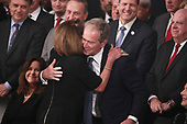 Former President George W. Bush is embraced by House Democratic Leader Nancy Pelosi (D-CA) during an arrival service for former U.S. President George H.W. Bush as his body lies in state in the U.S. Capitol Rotunda in Washington, U.S., December 3, 2018. REUTERS/Jonathan Ernst/Pool