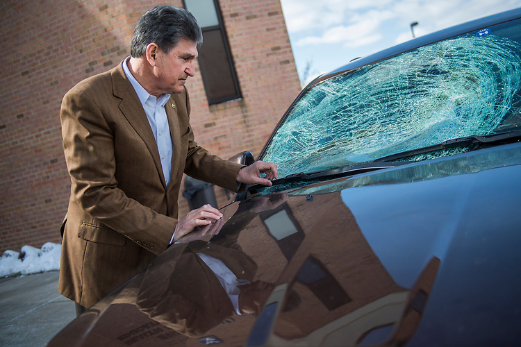 UNITED STATES - MARCH 16: Sen. Joe Manchin, D-W.Va., arrives for a town hall meeting at the WVU Robert C. Byrd Health Sciences Center in Martinsburg, W.Va., after his windshield was shattered by a piece of ice, March 16, 2017. Much of the discussion was regarding the American Health Care Act, the Republican's plan to repeal and replace the ACA. (Photo By Tom Williams/CQ Roll Call)