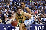 14 March 2015: Notre Dame's Pat Connaughton (24) and North Carolina's Brice Johnson (right). The Notre Dame Fighting Irish played the University of North Carolina Tar Heels in an NCAA Division I Men's basketball game at the Greensboro Coliseum in Greensboro, North Carolina in the ACC Men's Basketball Tournament quarterfinal game. Notre Dame won the game 90-82.
