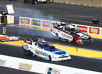 Jul 10, 2016; Joliet, IL, USA; NHRA funny car driver Bob Tasca III (near) defeats Tim Wilkerson during the Route 66 Nationals at Route 66 Raceway. Mandatory Credit: Mark J. Rebilas-USA TODAY Sports
