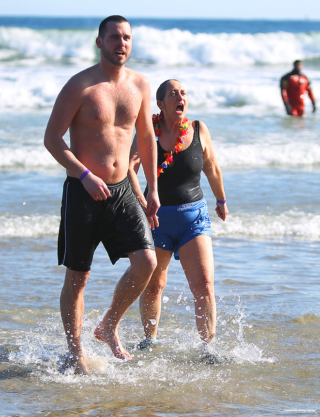 Denise Dawson-Smith, of Raymond, and her son, Bogart Smith of Manchester, come out of the water during the 13th Annual Penguin Plunge at Hampton Beach in Hampton, N.H., Sunday, Feb. 5, 2012.  (Portsmouth Herald Photo Cheryl Senter)