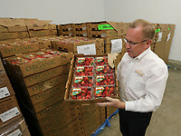 Feb. 20, 2019. San Diego, CA. USA| CEO of  Feeding San Diego CEO Vince Hall in the refrigerator with strawberries. | Photos by Jamie Scott Lytle. Copyright.