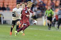 Houston, TX - Friday December 9, 2016: Andre Shinyashiki (9) of the Denver Pioneers gains control of a loose ball in the first half against the Wake Forest Demon Deacons at the  NCAA Men's Soccer Semifinals at BBVA Compass Stadium.