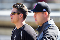 Cincinnati Bearcats Director of Baseball Operations John Lackaff (left) watches infield practice with head coach Ty Neal prior to the game against the Radford Highlanders at Wake Forest Baseball Park on February 22, 2014 in Winston-Salem, North Carolina.  The Highlanders defeated the Bearcats 6-5.  (Brian Westerholt/Four Seam Images)