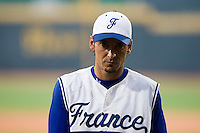 20 August 2007: Pitcher #10 Samuel Meurant walks into the dugout during the Czech Republic 6-1 victory over France in the Good Luck Beijing International baseball tournament (olympic test event) at the Wukesong Baseball Field in Beijing, China.