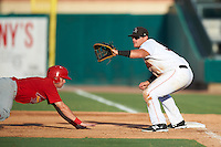 Jupiter Hammerheads first baseman Taylor Ard (30) waits for a throw as Andrew Sohn (5) dives back to the bag during a game against the Palm Beach Cardinals on August 13, 2016 at Roger Dean Stadium in Jupiter, Florida.  Jupiter defeated Palm Beach 6-2.  (Mike Janes/Four Seam Images)