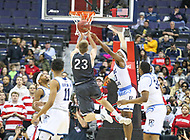 Washington, DC - March 11, 2018: Rhode Island Rams guard Stanford Robinson (13) tries to block Davidson Wildcats forward Peyton Aldridge (23) shot during the Atlantic 10 championship game between Rhode Island and Davidson at  Capital One Arena in Washington, DC.   (Photo by Elliott Brown/Media Images International)