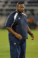 12 August 2011:  FIU Strength and Conditioning Coach Roderick Moore puts players through cool-off exercises after a scrimmage held as part of the FIU 2011 Panther Preview at University Park Stadium in Miami, Florida.