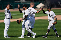 25th July 2020, Chicago, IL, USA;  Chicago White Sox players celebrate after defeating the Minnesota Twins by the score of 10-3 at Guaranteed Rate Field on July 25, 2020 in Chicago, IL.