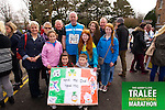 Dan O' Connor 307, welcomed at the finish by Erica, Lynda, Mark O'Connor, Niamb, Rachel O'Regan, Lynda, Maura Donal, Dan, Con O'Connor at the Kerry's Eye Tralee International Marathon on Sunday 16th March 2014.