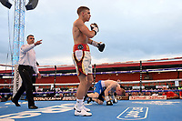 Dennis McCann (white shorts) defeats Kamil Jaworek  during at Boxing Show at Stevenage Football Club on 18th May 2019