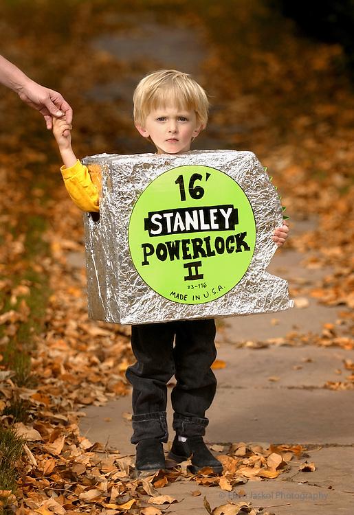 Denver, Colorado.  October 12, 2004}   Halloween costumes.  Tape measure is Jack Stade, 3, from Lafayette.  (Photo by Ellen Jasko/Rocky Mountain Newsl)