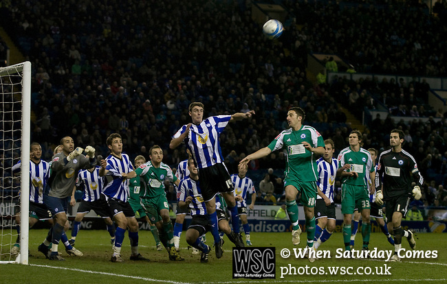 Home team defender Darren Potter rises to clear a last-minute corner as Sheffield Wednesday take on Peterborough United in a Coca-Cola Championship match at Hillsborough Stadium, Sheffield. The home side won by 2 goals to 1 giving Alan Irvine his third straight win since taking over as Wednesday's manager.