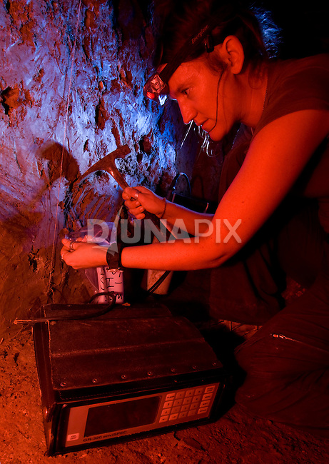"Geologist Kira Westaway from the University of Wollongong samples sediment for use in thermoluminescence dating, one of six techniques used to develop a timeline for Liang Bua Cave, discovery site of the Flores ""hobbit, Homo floresiensis"