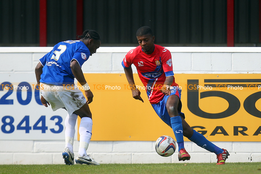 Nathan Smith of Chesterfield and Medy Elito of Dagenham and Redbridge - Dagenham and Redbridge vs Chesterfield, Sky Bet League Two Football at the London Borough of Barking and Dagenham Stadium - 21/04/14 - MANDATORY CREDIT: Dave Simpson/TGSPHOTO - Self billing applies where appropriate - 0845 094 6026 - contact@tgsphoto.co.uk - NO UNPAID USE