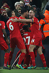 Divock Origi of Liverpool is mobbed after scoring the first goal during the Premier League match at the Anfield Stadium, Liverpool. Picture date: November 26th, 2016. Pic Simon Bellis/Sportimage