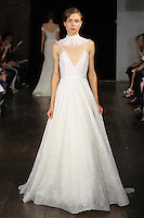 """Model walks runway in a """"Promise"""" bridal gown from the Alyne by Rita Vinieris Fall 2017 collection on October 7th, 2016 during New York Bridal Fashion Week."""