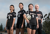 The Occidental College women's soccer team's three award winners, from left; Michaela Tsuha '16, 1st Team All-SCIAC, Taryn Ng '15, 1st Team All-SCIAC & Brine Award of Distinction and Julie Khil '17, SCIAC Women's Soccer Athlete of the Year. Coach Colm McFeely, Assistant Director of Athletics and head women's soccer coach is at far right. Dec. 11, 2014. (Photo by Marc Campos, Occidental College Photographer)