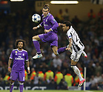 Gareth Bale of Real Madrid in action with Daniel Alves of Juventus during the Champions League Final match at the Millennium Stadium, Cardiff. Picture date: June 3rd, 2017.Picture credit should read: David Klein/Sportimage