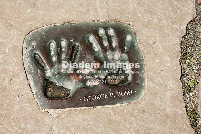 Cast handprints of George P. Bush on the White House grounds during a public open house tour in 2007.