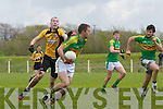 Knocknagoshal's Mike Brosnan breaks past Michéal Walsh of Asdee last Sunday afternoon in Asdee