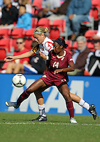 COLLEGE PARK, MD - OCTOBER 21, 2012:  Olivia Wagner (11) of the University of Maryland tackles Tiffany McCarty (14) of Florida State during an ACC women's match at Ludwig Field in College Park, MD. on October 21. Florida won 1-0.