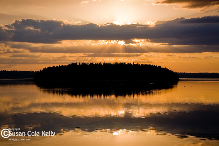 A sunset reflected on a quiet bay in Downeast ME, USA