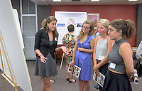 "From left, Emily Applewhite '16 talks about her research on ""Living in the Hybrid Zone: Testing the Species Squabble with two Mexican Highland Birds"" with Emma White '16, Caitlin Lingelbach '16 and Lisa Najarian '16. After researching all summer, Occidental College students present their work at the annual Summer Undergraduate Research Conference on July 29, 2015.<br /> (Photo by Marc Campos, Occidental College Photographer)"