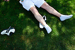 "Larry Hall rests under the shade of a tree outside of Gate 6 of The Masters Golf Tournament after spending half the day on the course of The Augusta National Golf Club on the second practice day of the Augusta, Georgia tournament, April 6, 2010. The high for the day was 92 degrees. ""I think Phil [Mickelson] will win, he's who I'm rooting for,"" the Atlanta golf fan said."