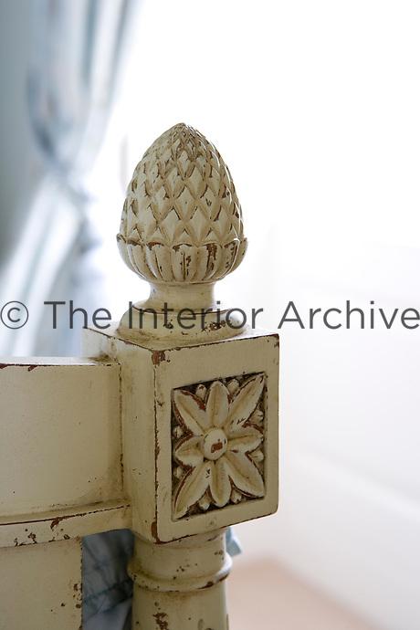 Detail shot of carved wooden bed post