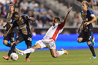 Raymon Gaddis (28) of the Philadelphia Union and Darel Russell (16) of Toronto FC look to play the ball. The Philadelphia Union defeated Toronto FC 1-0 during a Major League Soccer (MLS) match at PPL Park in Chester, PA, on October 5, 2013.