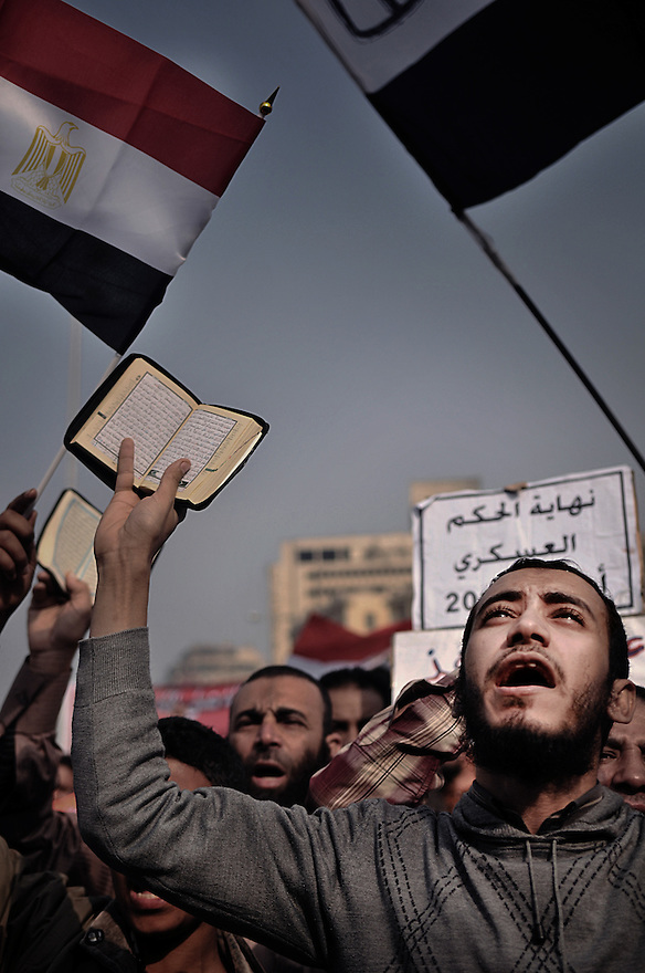 Young salafist showing the Coran in a demonstration in Cairo.Thousands of Islamist and secular protesters gathered in Cairo's Tahrir Square today for a mass rally to press the ruling military to hand over power to a civilian government.