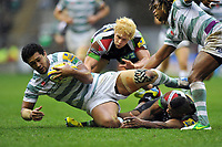 Chris Hala'ufia is tackled to ground. Big Game 5 Aviva Premiership match, between Harlequins and London Irish on December 29, 2012 at Twickenham Stadium in London, England. Photo by: Patrick Khachfe / Onside Images