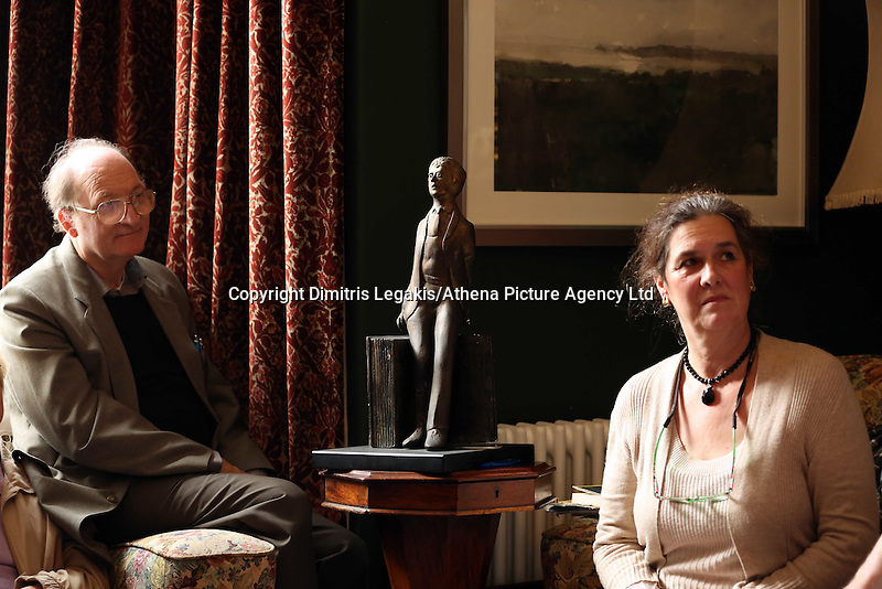 Swansea, UK. Saturday 25 October 2014<br /> Pictured: A Dylan Thomas statuette between Kirsten Jones (R) and a member of her audience in the front room of Dylan Thomas' birthplace.<br /> Re: Dylan Thomas birthday centenary celebrations at his birthplace, 5 Cwmdonkin Drive, Swansea, south Wales.