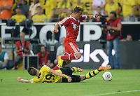 FUSSBALL   1. BUNDESLIGA   SAISON 2013/2014   SUPERCUP Borussia Dortmund - FC Bayern Muenchen           27.07.2013 Mario Goetze (FC Bayern Muenchen) graetscht Xherdan Shaqiri (FC Bayern Muenchen) ab
