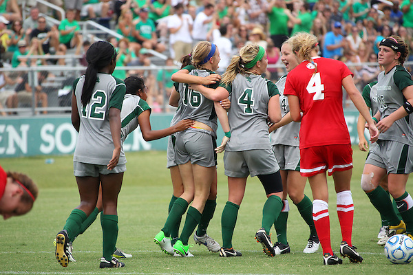 Denton, TX - AUGUST 31:  Michelle Young #16 of the North Texas Mean Green soccer celebrates scoring a goal  with Karla Pineda #9 and Carly McDowell #4 against University of Houston Cougars at the Mean Green Village Soccer Field on August 31, 2012 in Denton, Texas. NT won 2-1.(Photo by Rick Yeatts)