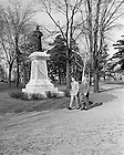 GPHR 45/0055:  Two male students waking in front of the Sorin Statue on Main Quad, c1950s.<br /> Image from the University of Notre Dame Archives.